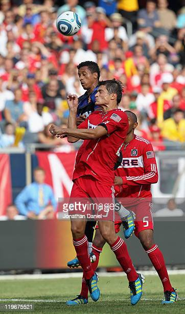 Nani of Manchester United and Josip Mikulic of the Chicago Fire battle for a header in a friendly match during the World Football Challenge 2011 at...