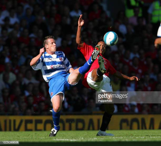 Nani of Manchester United and Nicky Shorey of Reading in action during the Barclays Premier League match between Manchester United and Reading at Old...