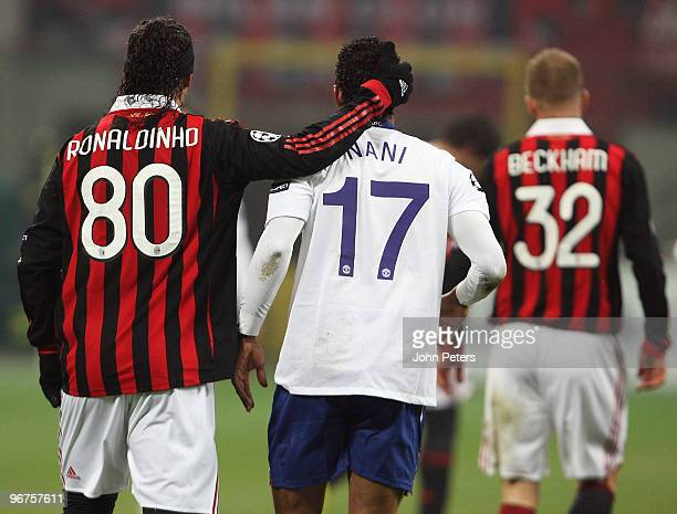 Nani of Manchester United and Ronaldinho of AC Milan in action during the UEFA Champions League First KnockOut Round match between AC Milan and...