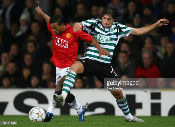 Nani of Manchester United battles for the ball with Abel of Sporting Lisbon during the UEFA Champions League Group F match between Manchester United...
