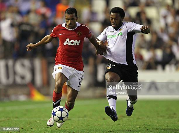 Nani of Manchester United battles for the ball with Manuel Fernandes of Valencia during the UEFA Champions League Group C match between Valencia and...
