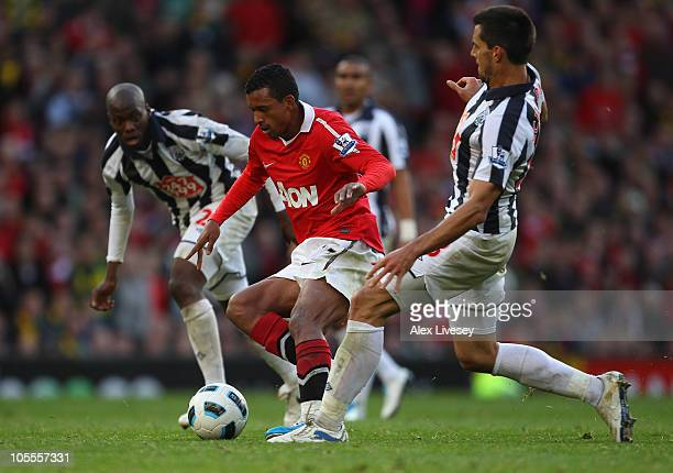 Nani of Manchester United beats Paul Scharner of West Bromwich Albion during the Barclays Premier League match between Manchester United and West...