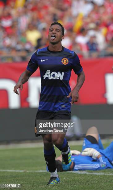 Nani of Manchester United celebrates a second half goal past Jon Conway of the Chicago Fire in a friendly match during the World Football Challenge...
