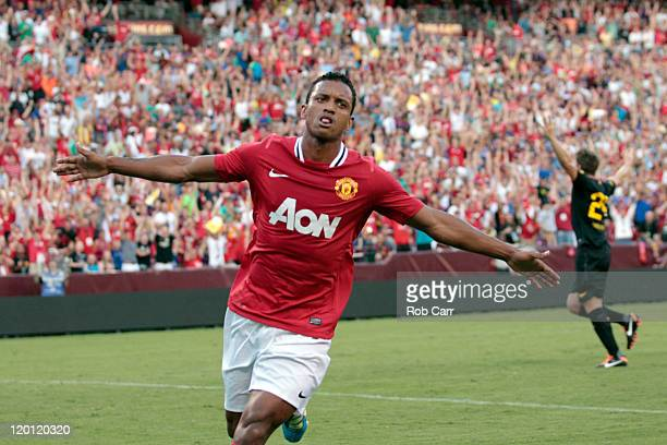Nani of Manchester United celebrates scoring a first half goal against Barcelona during a friendly match at FedExField on July 30 2011 in Landover...