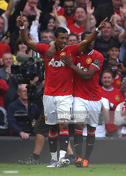 Nani of Manchester United celebrates scoring his team's second goal with team mate Patrice Evra during the Barclays Premier League match between...