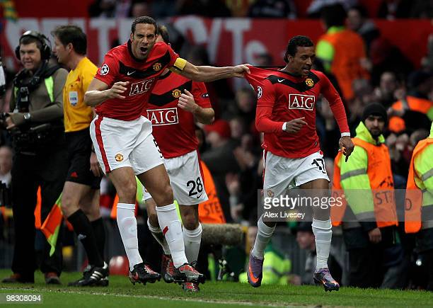 Nani of Manchester United celebrates scoring his team's second goal with team mate Rio Ferdinand during the UEFA Champions League Quarter Final...