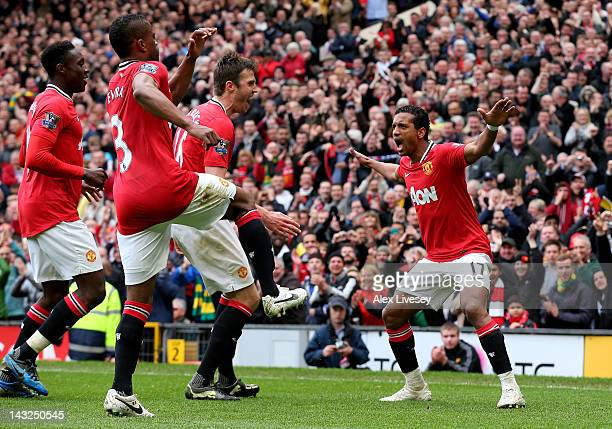 Nani of Manchester United celebrates scoring his team's third goal with his team mates during the Barclays Premier League match between Manchester...