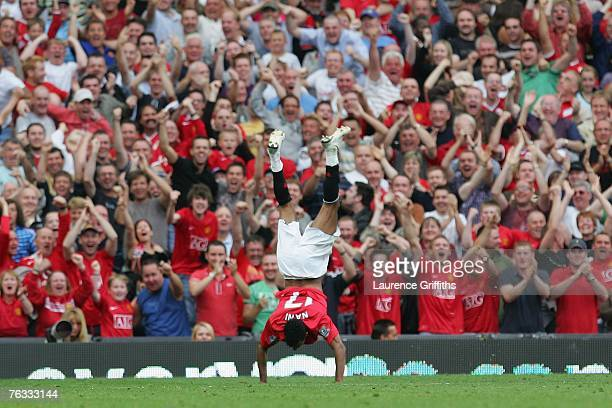 Nani of Manchester United celebrates scoring the opening goal during the Barclays Premier League match between Manchester United and Tottenham...