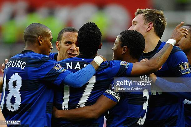 Nani of Manchester United celebrates scoring the opening goal with team mates Ashley Young Rio Ferdinand Patrice Evra and Phil Jones during the...