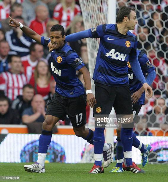 Nani of Manchester United celebrates scoring their first goal during the Barclays Premier League match between Stoke City and Manchester United at...