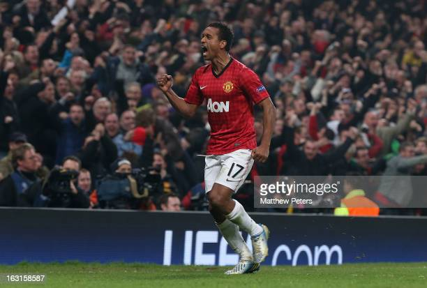 Nani of Manchester United celebrates Sergio Ramos of Real Madrid scoring an own-goal during the UEFA Champions League match between Manchester United...