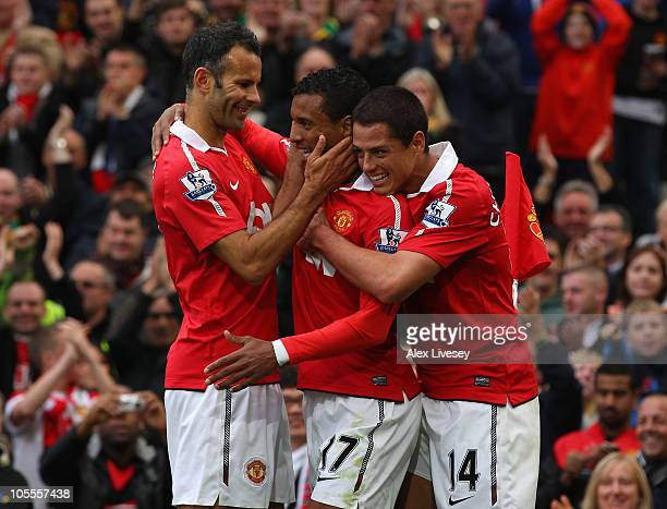 Nani of Manchester United celebrates with Ryan Giggs and Javier Hernandez after scoring the second goal during the Barclays Premier League match...