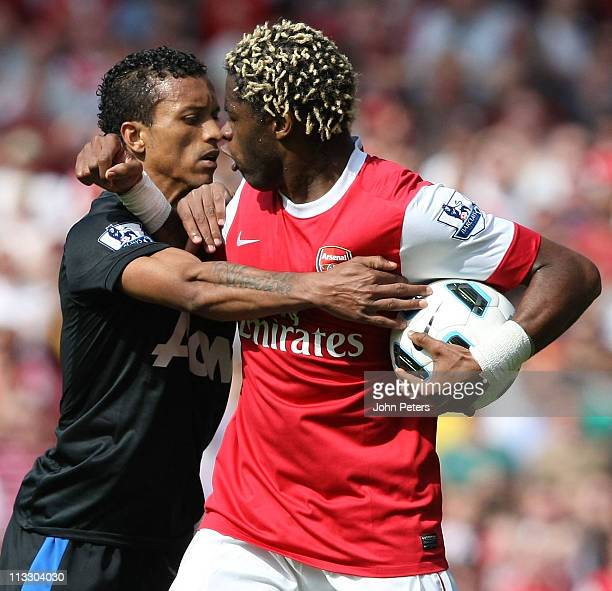 Nani of Manchester United clashes with Alexandre Song of Arsenal during the Barclays Premier League match between Arsenal and Manchester United at...
