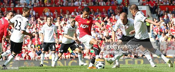Nani of Manchester United clashes with Clint Dempsey and Carlo Salcido of Fulham during the Barclays Premier League match between Manchester United...