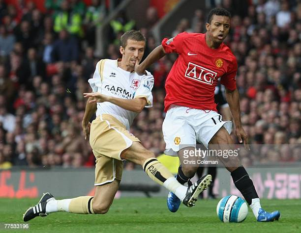 Nani of Manchester United clashes with Gary O'Neil of Middlesbrough during the Barclays FA Premier League match between Manchester United and...