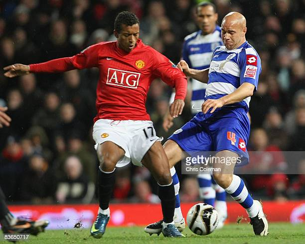 Nani of Manchester United clashes with Gavin Mahon of Queens Park Rangers during the Carling Cup Fourth Round match between Manchester United and...