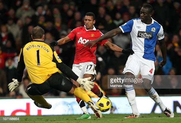 Nani of Manchester United clashes with Paul Robinson and Christopher Samba of Blackburn Rovers during the Barclays Premier League match between...