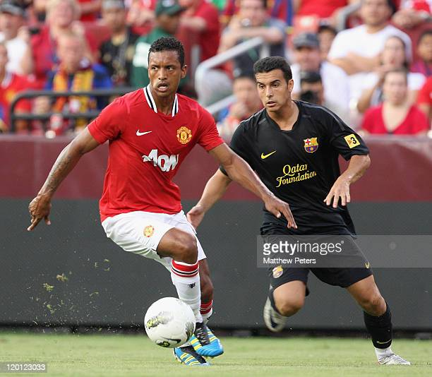 Nani of Manchester United clashes with Pedro of Barcelona during the pre-season friendly match between Manchester United and Barcelona as part of...
