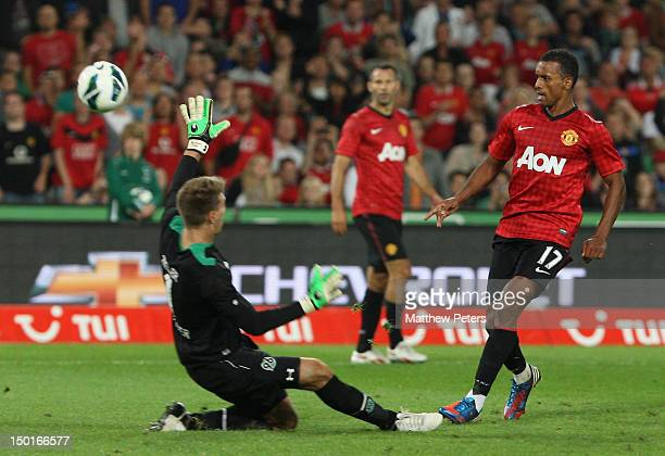 Nani of Manchester United clashes with Ron Robert Zieler of 96 Hannover during the pre-season friendly match between Hannover 96 and Manchester...