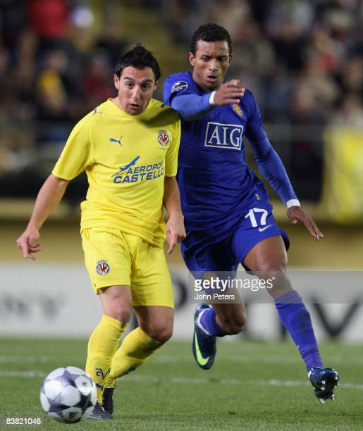 Nani of Manchester United clashes with Santi Cazorla of Villarreal during the UEFA Champions League Group E game between Villarreal and Manchester...