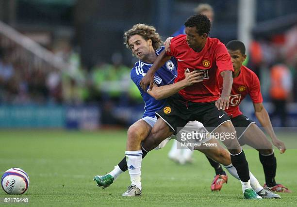 Nani of Manchester United clashes with Sergio Torres of Peterborough United during the preseason friendly match between Peterborough United and...