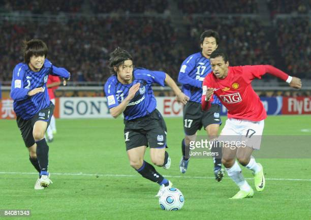 Nani of Manchester United clashes with Sota Nakazawa Akira Kaji and Tomokazu Kyojin of Gamba Osaka during the FIFA World Club Cup SemiFinal match...