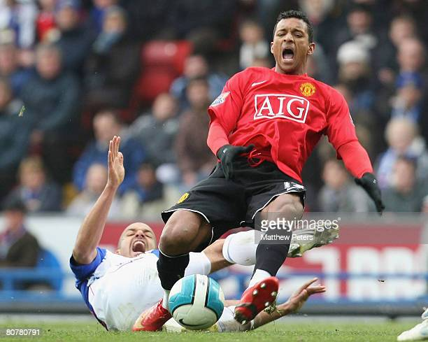 Nani of Manchester United clashes with Steven Reid of Blackburn Rovers during the Barclays FA Premier League match between Blackburn Rovers and...