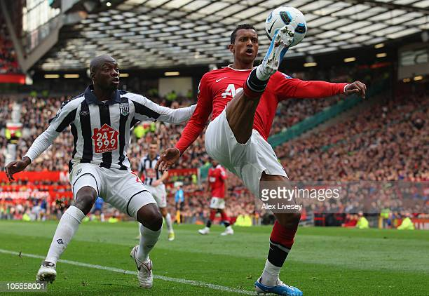Nani of Manchester United controls the ball under pressure from Youssouf Mulumbu of West Bromwich Albion during the Barclays Premier League match...