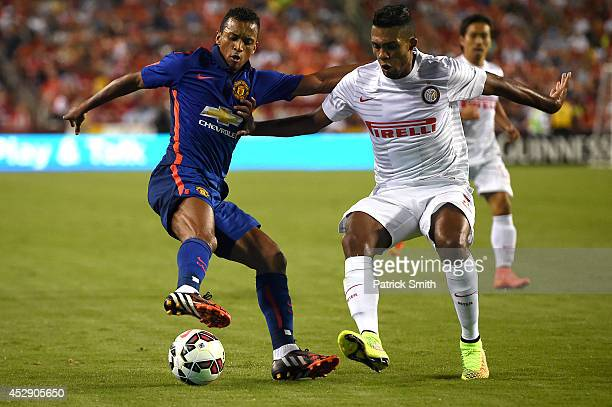 Nani of Manchester United dribbles past Juan Jesus of Inter Milan in the second half during their match in the International Champions Cup 2014 at...