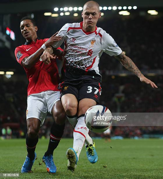 Nani of Manchester United in action with Martin Skrtel of Liverpool during the Capital Cup Third Round match between Manchester United and Liverpool...