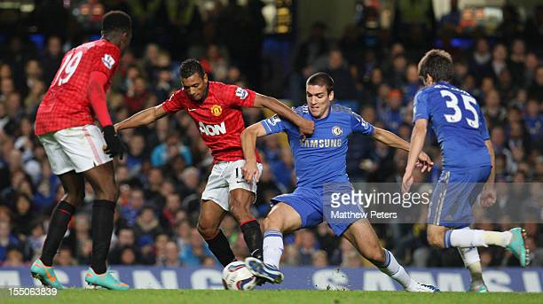 Nani of Manchester United in action with Oriol Romeu of Chelsea during the Capital One Cup Fourth Round match between Chelsea and Manchester United...