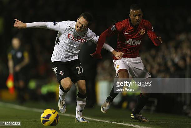 Nani of Manchester United in action with Sashcha Riether of Fulham during the Barclays Premier League match between Fulham and Manchester United at...