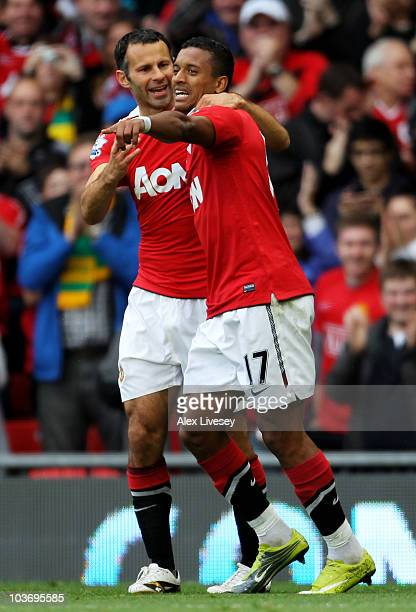 Nani of Manchester United is congratulated by team mate Ryan Giggs after scoring his team's second goal during the Barclays Premier League match...