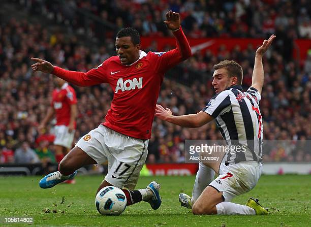 Nani of Manchester United is tackled by James Morrison of West Bromwich Albion during the Barclays Premier League match between Manchester United and...