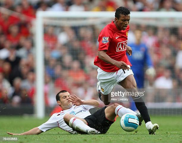 Nani of Manchester United is tackled by Ross Wallace of Sunderland during the Barclays Premier League match between Manchester United and Sunderland...