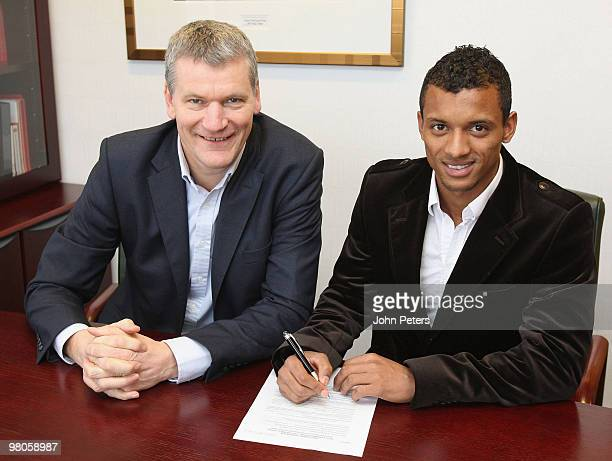 Nani of Manchester United poses with Chief Executive David Gill after signing an extension to his contract at Old Trafford on March 26 2010 in...