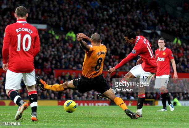 Nani of Manchester United shoots past Karl Henry of Wolves to score the opening goal during the Barclays Premier League match between Manchester...