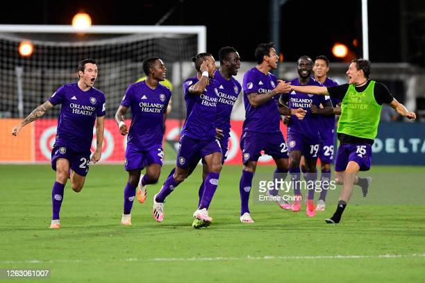 Nani of Orlando City and teammates celebrate their victory in the penalty shoot-out over Los Angeles FC during a quarter final match of MLS Is Back...