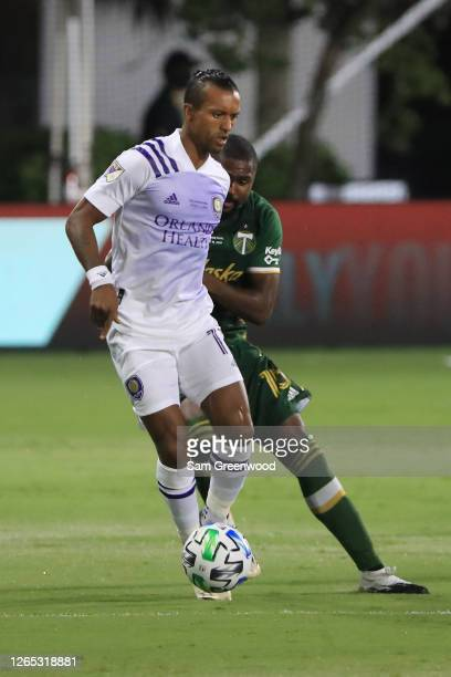 Nani of Orlando City fights for the ball with Chris Duvall of Portland Timbers during the final match of MLS Is Back Tournament between Portland...