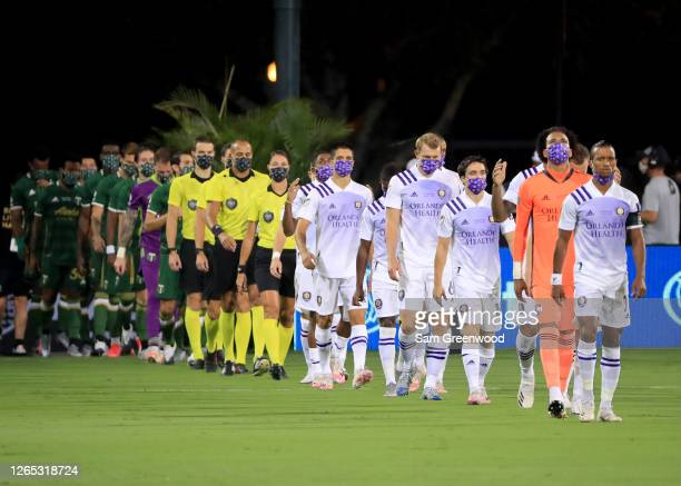 Nani of Orlando City leads his team as they walk onto the field before the final match of MLS Is Back Tournament between Portland Timbers and Orlando...
