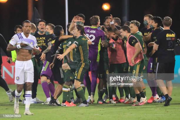 Nani of Orlando City looks dejected as players of Portland Timbers celebrate the Championship after the final match of MLS Is Back Tournament at ESPN...