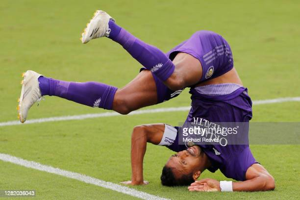 Nani of Orlando City SC tumbles over against Inter Miami CF during the first half at Inter Miami CF Stadium on October 24, 2020 in Fort Lauderdale,...