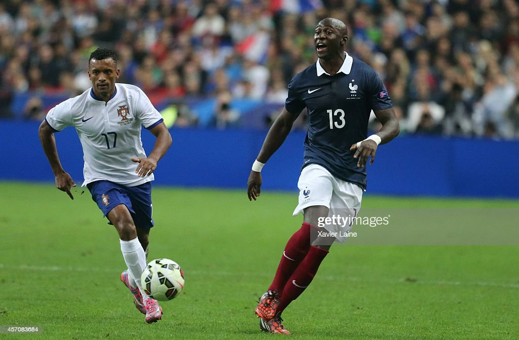 Nani of Portugal and Eliaquim Mangala of France during the International Friendly Soccer match between France and Portugal at Stade de France on october 11, 2014 in Paris, France.