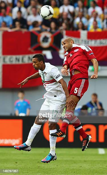 Nani of Portugal and Simon Poulsen of Denmark battle for the ball during the UEFA EURO 2012 group B match between Denmark and Portugal at Arena Lviv...