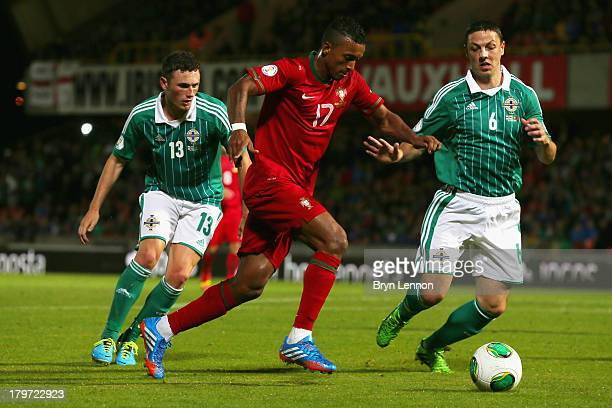 Nani of Portugal avoids Corry Evans and Chris Baird of Northern Ireland during the FIFA 2014 World Cup Qualifying Group F match between Northern...