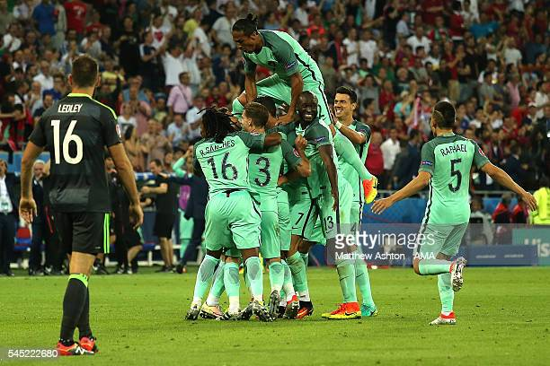 Nani of Portugal is mobbed by his team-mates after scoring a goal to make the score 2-0 during the UEFA Euro 2016 Semi Final match between Portugal...