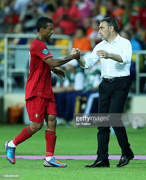 Nani of Portugal shakes hands with coach Paulo Bento as he is substituted during the UEFA EURO 2012 group B match between Portugal and Netherlands at...