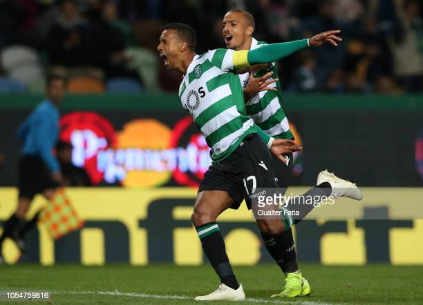 Nani of Sporting CP celebrates with teammate Bruno Gaspar of Sporting CP after scoring a goal during the Liga NOS match between Sporting CP and...