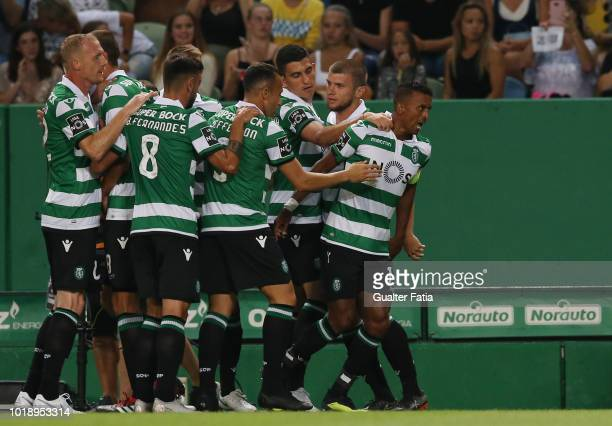 Nani of Sporting CP celebrates with teammates after scoring a goal during the Liga NOS match between Sporting CP and Vitoria FC at Estadio Jose...
