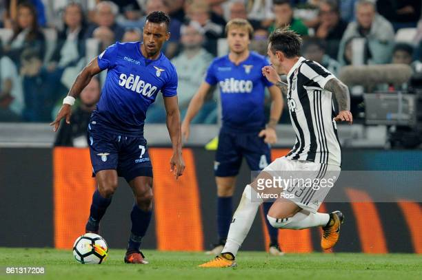Nani of SS Lazio compete for the ball with Federico Bernardeschiof Juventus during the Serie A match between Juventus and SS Lazio on October 14 2017...